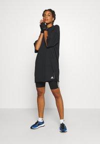 adidas Performance - TEE - T-shirts med print - black - 1