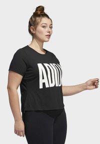 adidas Performance - UNIVERSE T-SHIRT - T-shirts print - black - 2
