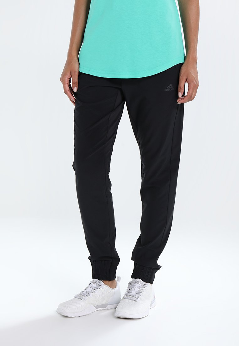 adidas Performance - WOVEN - Pantalones deportivos - black