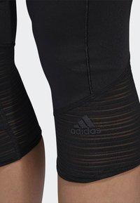 adidas Performance - HOW WE DO 3/4-TIGHTS - Pantalon 3/4 de sport - black - 3