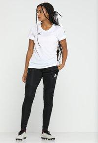adidas Performance - TIRO AEROREADY CLIMACOOL FOOTBALL PANTS - Spodnie treningowe - black/white - 1