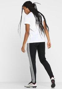 adidas Performance - TIRO AEROREADY CLIMACOOL FOOTBALL PANTS - Spodnie treningowe - black/white - 2