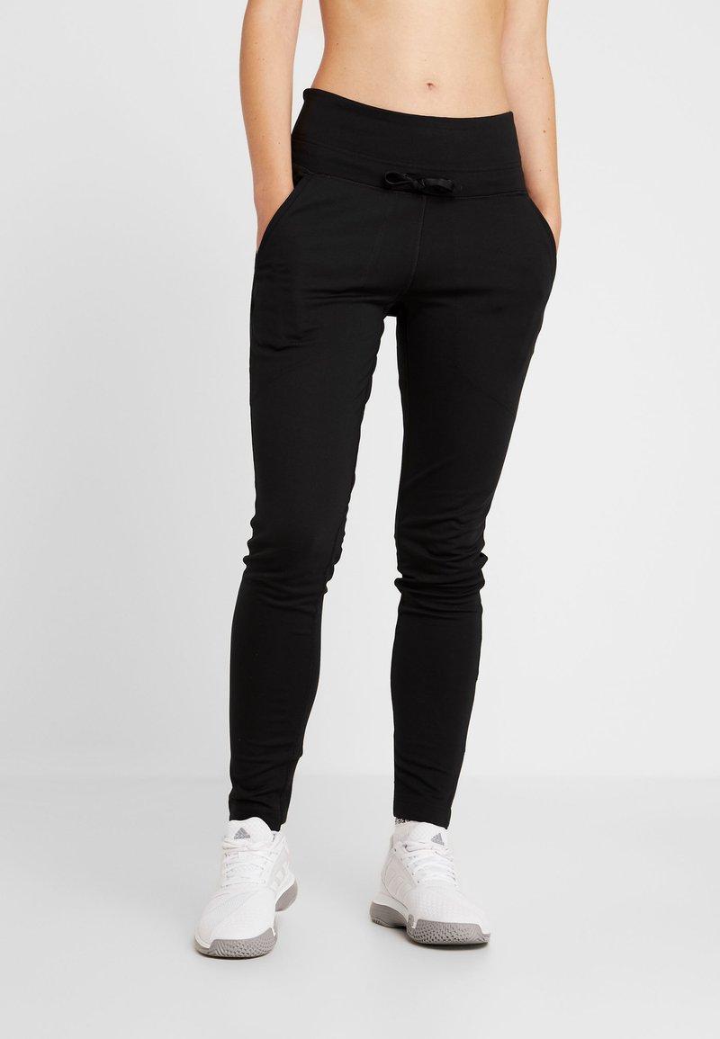adidas Performance - CITY - Tracksuit bottoms - black