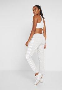 adidas Performance - PANT - Tracksuit bottoms - medium greyheather/off white/white - 2