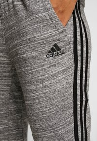 adidas Performance - PANT - Tracksuit bottoms - black/off white - 4