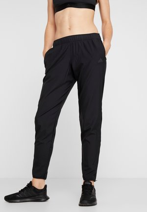 ASTRO PANT  - Tracksuit bottoms - black