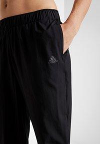 adidas Performance - ASTRO PANT  - Tracksuit bottoms - black - 3
