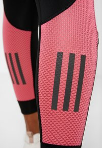 adidas Performance - OWN THE RUN - Tights - black/real pink - 7