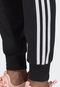 adidas Performance - ESSENTIALS 3-STRIPES JOGGERS - Tracksuit bottoms - black - 3
