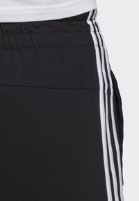 adidas Performance - ESSENTIALS 3-STRIPES JOGGERS - Tracksuit bottoms - black - 4