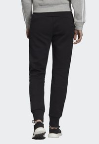 adidas Performance - MUST HAVES 3-STRIPES JOGGERS - Tracksuit bottoms - black - 1