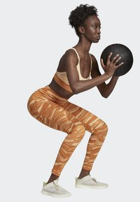 adidas Performance - BELIEVE THIS WANDERLUST LEGGINGS - Leggings - orange - 1
