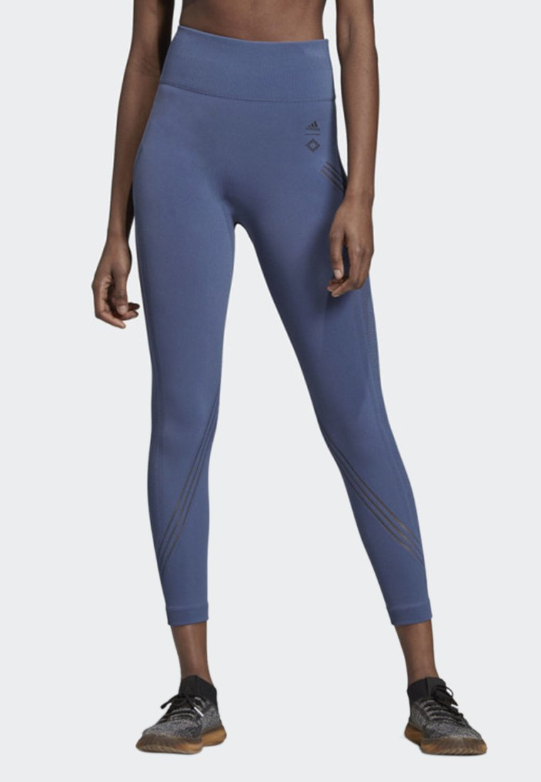 adidas Performance - WANDERLUST WARP KNIT LEGGINGS - Tights - blue