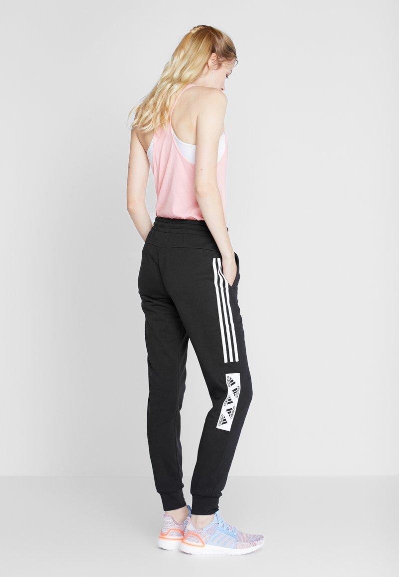 adidas Performance - BLOCK PANT - Teplákové kalhoty - black