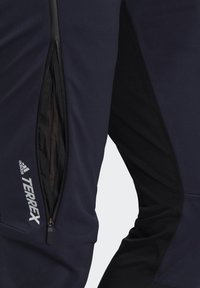 adidas Performance - TERREX SKYRUNNING SOLID TRACKSUIT BOTTOMS - Collants - blue