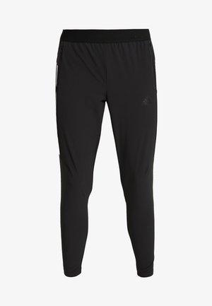 3S - Pantalones deportivos - black/white