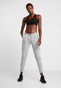 adidas Performance - Pantalones deportivos - solid grey/raw white - 1