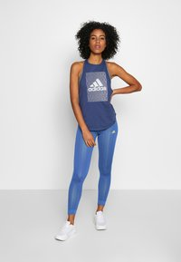 adidas Performance - OWN THE RUN - Leggings - tecind/shoyel - 1