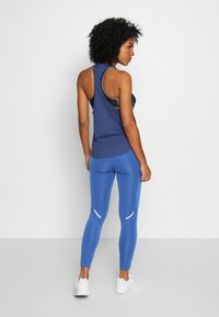 adidas Performance - OWN THE RUN - Leggings - tecind/shoyel