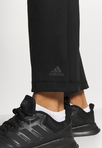 adidas Performance - PANT - Tracksuit bottoms - black - 3