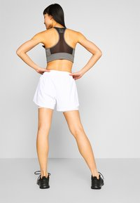 adidas Performance - SHORT - Sports shorts - white - 2