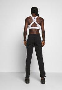 adidas Performance - ESSENTIALS 3STRIPES OPEN HEM SPORT PANTS - Spodnie treningowe - black/white - 2