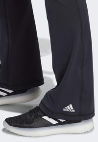 adidas Performance - BRUSHED BOOTCUT JOGGERS - Tracksuit bottoms - black - 4