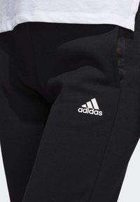 adidas Performance - Tracksuit bottoms - black - 6