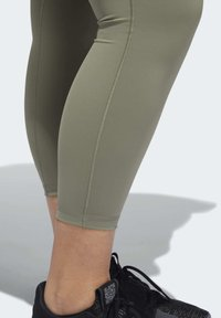 adidas Performance - BELIEVE THIS SOLID 7/8 LEGGINGS - Tights - green - 6