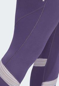 adidas Performance - HOW WE DO 7/8 LEGGINGS  (PLUS SIZE) - Leggings - purple - 6