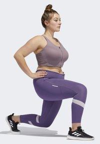 adidas Performance - HOW WE DO 7/8 LEGGINGS  (PLUS SIZE) - Leggings - purple - 4
