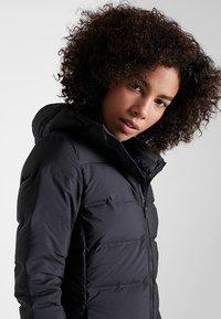 adidas Performance - HELIONIC HOODED  - Winter jacket - black - 3