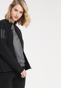 adidas Performance - OWN THE RUN - Sports jacket - black - 3
