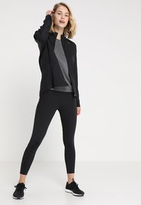adidas Performance - OWN THE RUN - Sports jacket - black - 1