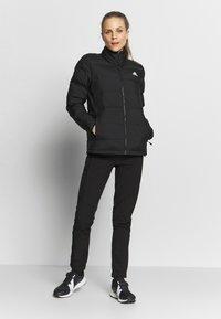 adidas Performance - HELIONIC  - Gewatteerde jas - black - 1