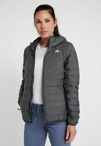 adidas Performance - VARILITE 3-STRIPES SOFT HOODED DOWN JACKET - Winter jacket - carbon - 0