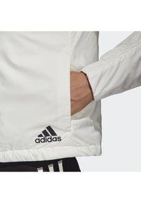adidas Performance - TERREX LIGHT INSULATED - Winter jacket - white - 4