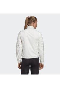 adidas Performance - TERREX LIGHT INSULATED - Winter jacket - white - 2