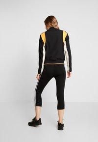adidas Performance - CITY JACKET - Veste de survêtement - black/linen - 2