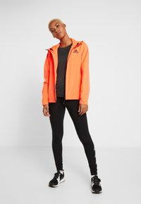 adidas Performance - BSC 3-STRIPES RAIN.RDY - Waterproof jacket - coral - 1