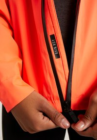 adidas Performance - BSC 3-STRIPES RAIN.RDY - Waterproof jacket - coral - 5