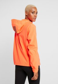 adidas Performance - BSC 3-STRIPES RAIN.RDY - Waterproof jacket - coral - 2