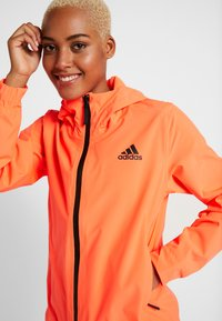 adidas Performance - BSC 3-STRIPES RAIN.RDY - Waterproof jacket - coral - 3