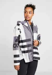 adidas Performance - URBAN ALLOVER PRINT WIND.RDY - Waterproof jacket - white - 0
