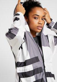 adidas Performance - URBAN ALLOVER PRINT WIND.RDY - Waterproof jacket - white - 4