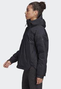 adidas Performance - URBAN INSULATED RAIN JACKET - Sports jacket - black - 3