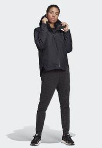 adidas Performance - URBAN INSULATED RAIN JACKET - Sports jacket - black - 1