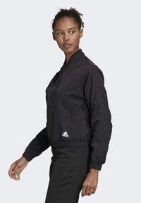adidas Performance - WOVEN BOMBER JACKET - Training jacket - black - 3