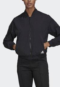 adidas Performance - WOVEN BOMBER JACKET - Training jacket - black - 5