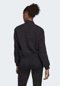 adidas Performance - WOVEN BOMBER JACKET - Training jacket - black - 1